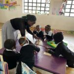 One of our teachers giving table instructions